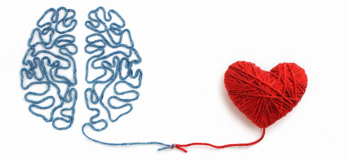 A heart and brain made of yarn with a knot connecting them