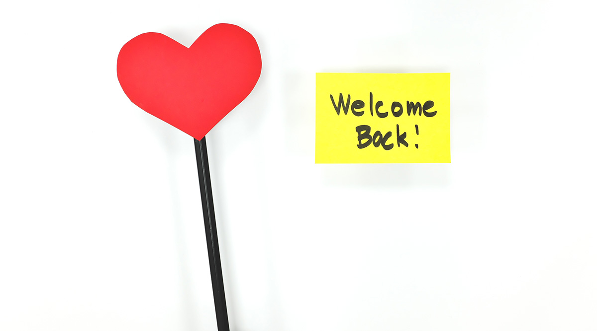 """A heart cutout and a note that says """"Welcome Back!"""""""