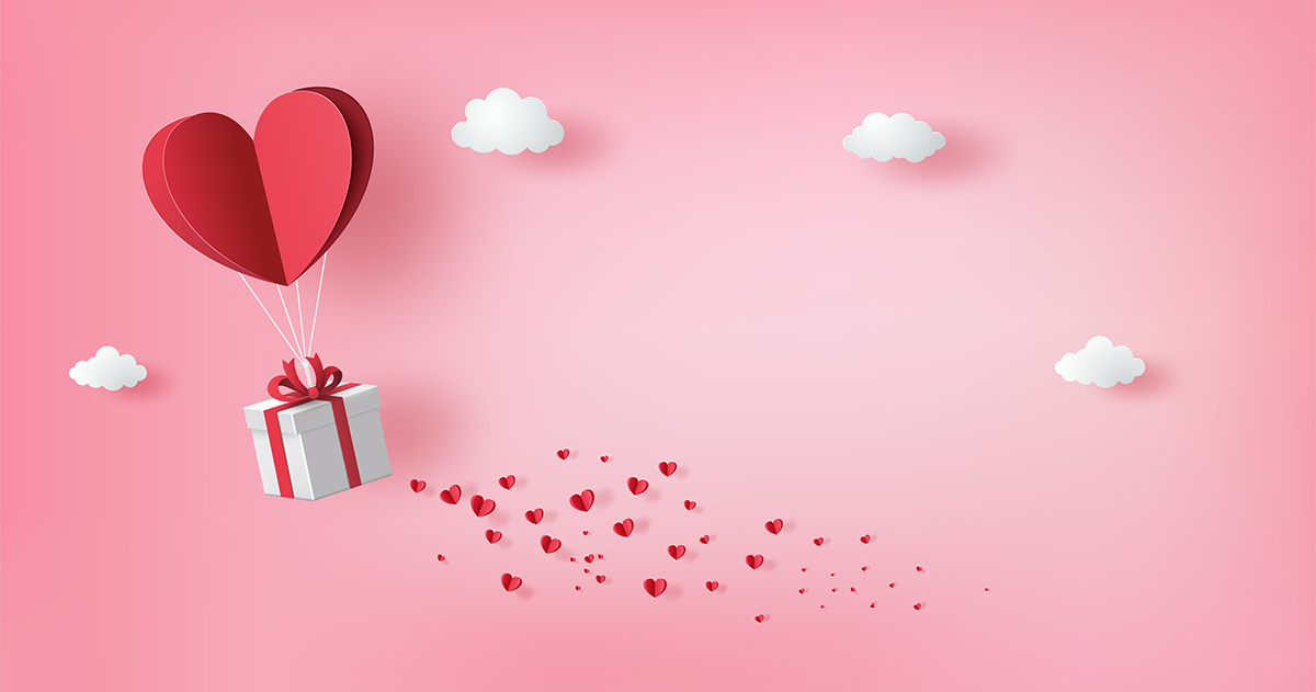 A gift-wrapped box held aloft by a heart-shaped balloon, with hearts and clouds surrounding it