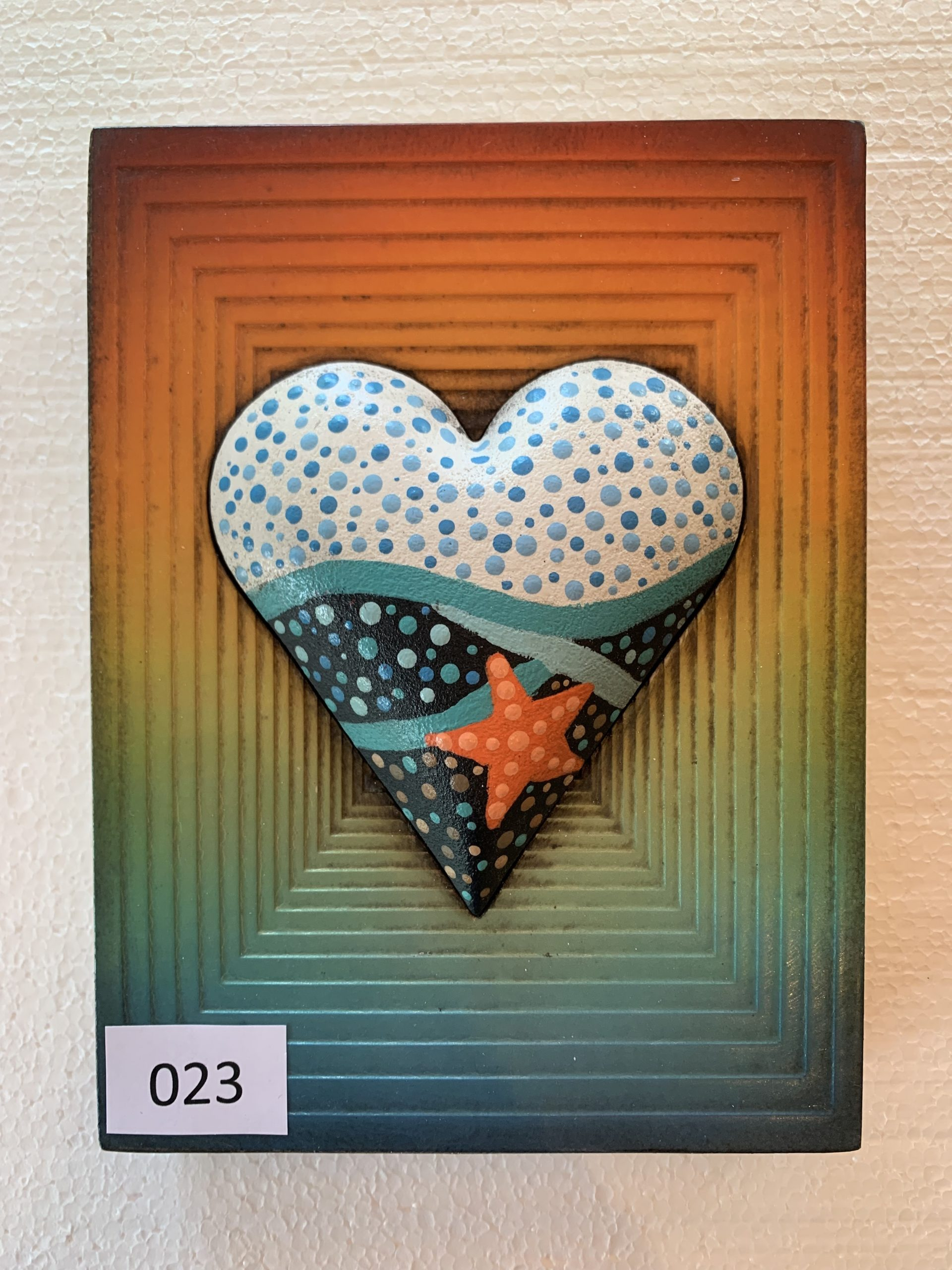 A memory block tile with a heart shape in the centre
